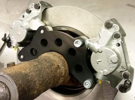 Volvo 240 Motorsport double caliper adapters.